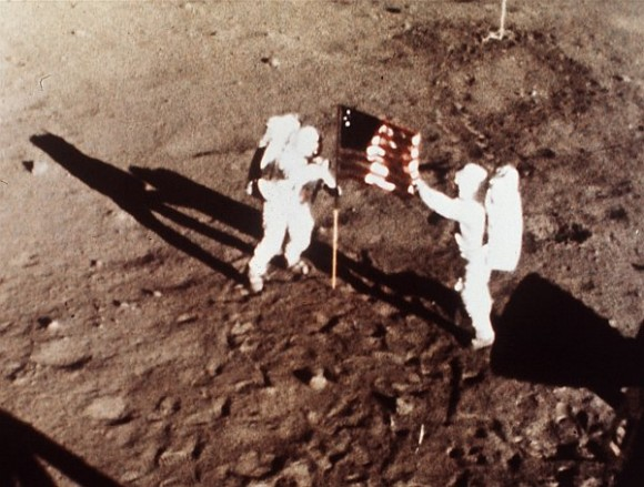 Armstrong and Aldrin plant flag