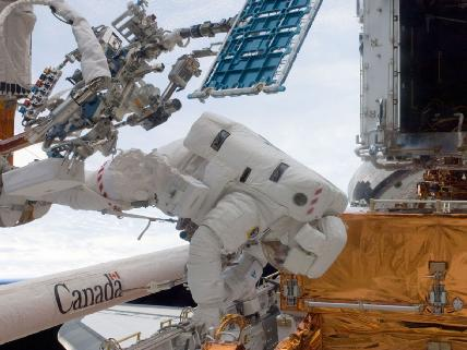 Michael Good spacewalking