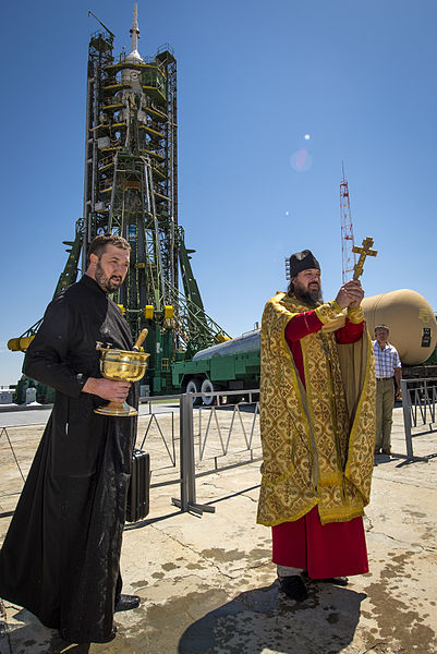 priest-blessing-rocket.jpg